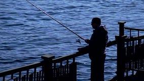 Rybaka połów z przędzalnictwem, sylwetka zbiory