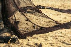 Rybaka ` s sprzęt na piaska tle Zdjęcia Royalty Free