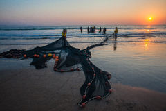 Rybaka sieć Rozprzestrzeniający Plażowy wschód słońca Obrazy Royalty Free