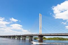 Rybalskyi Bridge through Dnieper River Stock Photography