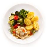 Rybi naczynie - piec rybi przepasuje i warzywa Obrazy Royalty Free