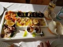 rybiego jedzenia pietruszki talerz piec morze obraz stock