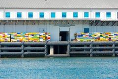 Rybołówstwo dok z kolorowymi skrzynkami obraz royalty free