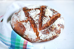 Rye artisan bread dusted with flour on a napkin, sourdough Stock Images