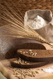 Rye Bread. Sliced rye bread with flour and grains Royalty Free Stock Photos