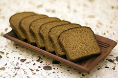 Rye-bread. Close-up on wood tray Stock Images