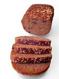 Rye bread. Rye bread, with sesame seeds and raisins, on a white background stock image