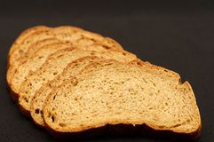 Rye bread. Cut loaf of rye bread isolated on black Stock Photos