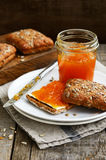 Rye bread and apricot jam sandwich topped with sunflower seeds Royalty Free Stock Photography