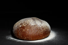Rye bread. On the black background Royalty Free Stock Photo