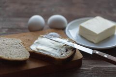 Rye bread with butter and boiled eggs on the village table royalty free stock photos
