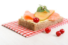 Rye bread with butter, salmon and pickled cucumber Royalty Free Stock Image