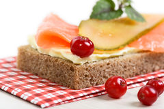 Rye bread with butter, salmon and pickled cucumber Royalty Free Stock Photos