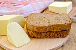 Rye bread with cheese and butter on board Stock Photo