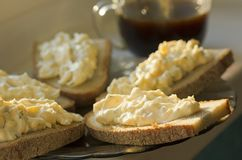 Rye bread with cheese and garlic appetizer and coffee Royalty Free Stock Photo