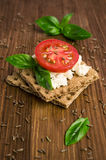 Rye bread with cheese, tomatoes, basil and thyme Stock Photos