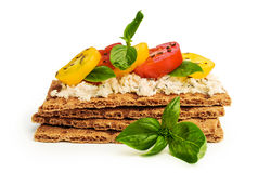 Rye bread with cheese, tomatoes, basil and thyme Royalty Free Stock Image