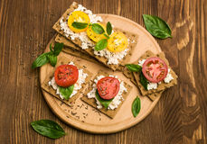 Rye bread with cheese, tomatoes, basil and thyme Stock Images