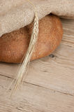 Rye bread, and corn on a wooden table Stock Photos