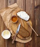 Rye bread and cream cheese. Pieces of rye bread with cream cheese and some honey Royalty Free Stock Photography