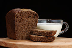 Rye bread and a cup of milk Royalty Free Stock Images