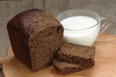 Rye bread and a cup of milk Stock Photos