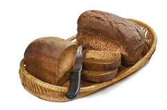 Rye bread, cut into chunks, and the knife Royalty Free Stock Photos