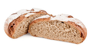 Rye bread cut in half. On white background stock photos