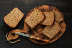 Rye bread is cut into pieces on a cutting board. Royalty Free Stock Photography