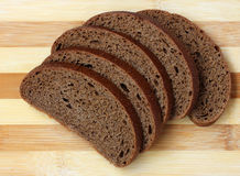 Rye bread, cut into pieces, lies on a chopping Board. Royalty Free Stock Images