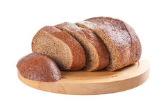 Rye bread on cutting board. Fresh rye sliced bread on cutting board isolated on white background Royalty Free Stock Photos