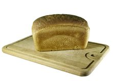 Rye-bread. On cutting board on white Stock Images