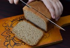 Rye bread, cutting on a chopping board Royalty Free Stock Photo