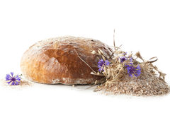 Rye bread decorated with cornflower. On white background Stock Photo