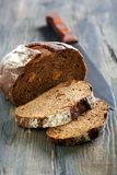 Rye bread with dried apricots and a knife. Royalty Free Stock Images
