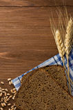 Rye bread and ears of wheat Royalty Free Stock Photo