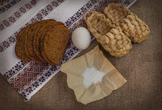 Rye bread, egg and salt on canvas Royalty Free Stock Images