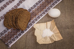 Rye bread, egg and salt on canvas Stock Images