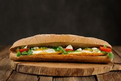 Rye bread egg sandwich with tomatoes and greens Stock Photos