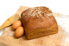 Rye bread and eggs on wood Stock Photo