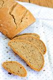 Rye bread with flaxseed. Homemade rye bread with flaxseed cutted in slices Royalty Free Stock Photography
