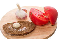 Rye bread with garlic and tomatoes _ Royalty Free Stock Images
