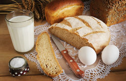 Rye bread and a glass of milk for dinner Stock Photography