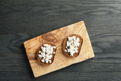 Rye bread grated with garlic and ricotta cheese Royalty Free Stock Photo