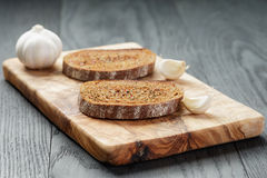 Rye bread grated with garlic Royalty Free Stock Image