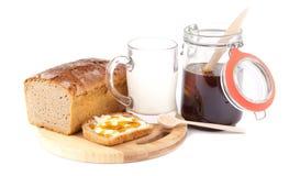 Rye bread with honey nad milk Royalty Free Stock Photo