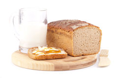 Rye bread with honey nad milk Stock Photography