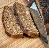 Rye bread with knife Royalty Free Stock Images