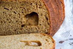 Rye bread with a large hole in the cut. Rye bread with a large hole in the cut royalty free stock photos