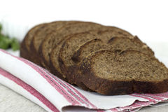 Rye bread on linen napkin. Rye bread  on linen napkin Royalty Free Stock Photography